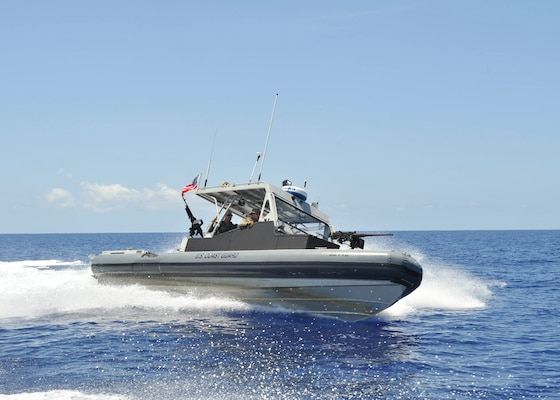 Coast Guardsmen from Port Security Unit 305 aboard a 32-foot Transportable Port Security Boat patrol a security zone off the coast of Guantanamo Bay, Cuba, Saturday, July, 15, 2017. Coast Guard PSUs serve as anti-terrorism force protection expeditionary units with boat crews and shore-side security teams capable of supporting port and waterway security anywhere the military operates.