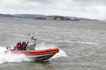 Crewmembers stationed aboard the Coast Guard Cutter Robert Ward, a Sentinel Class Fast Response Cutter, demonstrate the maneuverability of their 26-foot Over the Horizon IV Cutter Boat in San Francisco Bay, Feb. 28, 2019. The Robert Ward is the newest Coast Guard cutter to be stationed in California and will provide additional resources to the Coast Guard in emergency response, maritime smuggling, marine safety, environmental protection, search and rescue, and port security.