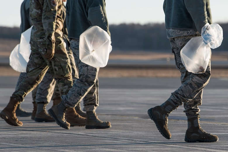 U.S. Airman from the 3rd Wing, 176th Wing, and 477th Fighter Group conduct a foreign object debris walk on the flightline at Joint Base Elmendorf-Richardson, Alaska, April 26, 2019. Airmen conducted the FOD walk to remove debris that could damage aircraft and hinder mission readiness.