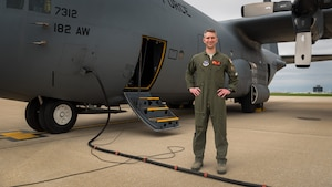 Airman posing with aircraft.