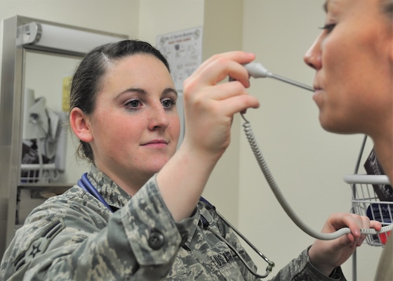 Airman First Class Lexie Gilotti, 359th Medical Group Family Health medical technician checks the temperature of a simulated patient, April 23, 2019, Joint Base San Antonio-Randolph, Texas. National Nurses Week begins each year on May 6th and ends on May 12th, Florence Nightingale's birthday.