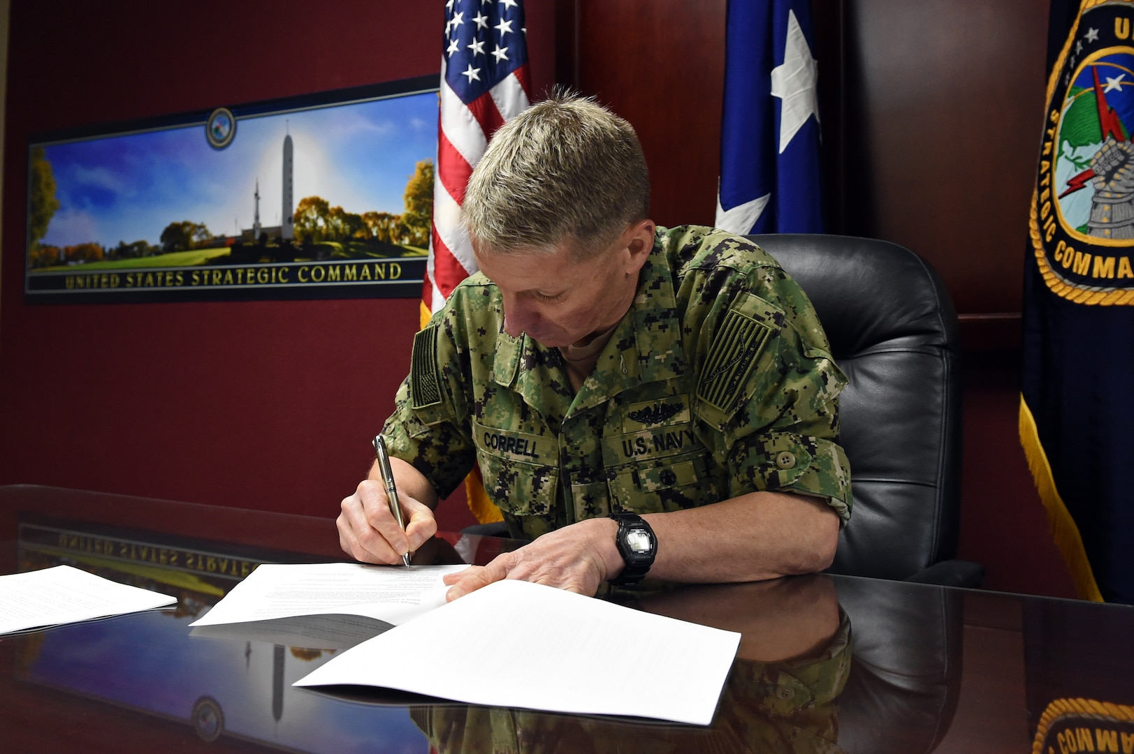 Rear Adm. Richard Correll, U.S. Strategic Command director of plans and policy, signs the United States-Romania Space Situational Awareness (SSA) agreement at USSTRATCOM Headquarters at Offutt Air Force Base, Neb., on April 4, 2019. SSA data-sharing agreements enhance multinational space cooperation and streamline the process for USSTRATCOM partners to request specific information gathered by USSTRATCOM's Joint Space Operations Center at Vandenberg Air Force Base, Calif. The information is crucial for launch support, satellite maneuver planning, support for on-orbit anomalies, electromagnetic interference reporting and investigation, satellite decommissioning activities and on-orbit conjunction assessments.