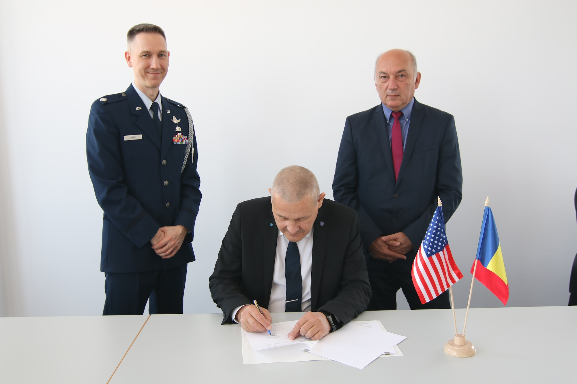 Dr. Phys. Marius-Ion Piso (center), President of Romanian Space Agency (ROSA), signs the United States-Romania Space Situational Awareness (SSA) agreement alongside Lt. Col. Matthew Kimsal (left), representative of the U.S. Embassy in Romania, and Mircea Cernat, Senior Engineer of ROSA, at ROSA headquarter in Bucharest, Romania, on April 25, 2019. The U.S. government partners with space-faring entities to promote the responsible, peaceful and safe use of space. SSA sharing agreements lay the foundation that allows USSTRATCOM to share information with allies and partners in support of launches, on-orbit maneuvers, anomaly resolution, de-commissioning activities and on-orbit conjunction assessments. SSA sharing is a foundational capability that affects all future space operations and projects.