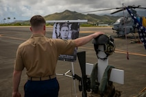 A U.S. Marine pays his respects during a memorial for U.S. Marine Corps Capt. Travis Brannon, Marine Corps Air Station Kaneohe Bay, Marine Corps Base Hawaii, Apr. 24, 2019. Capt. Brannon, HMLA-367 and Maj. Matthew M. Wiegand, Marine Aviation Weapons and Tactics Squadron One, were killed as a result of an AH-1Z Viper helicopter crash aboard Marine Corps Air Station Yuma training grounds, March 30, 2019, during routine training at the semi-annual Weapons and Tactics Instructor Course hosted by MAWTS-1. (U.S. Marine Corps photo by Sgt. Zachary Orr)