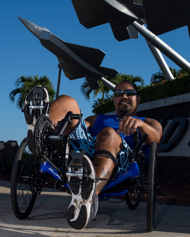 Retired Chief Master Sgt. Garrett Kuwada, originally from Honolulu, Hawaii, poses with his recumbent bike, which is one of the sports he will be participating in during the 2019 Wounded Warrior Games. Kuwada had a ruptured brain aneurysm resulting in blood around his brain and damage to his spinal cord and legs. He now suffers loss of coordination and balance, hearing, vision, speech and cognitive function. (U.S. Air Force photo by Tech. Sgt. Heather Redman)