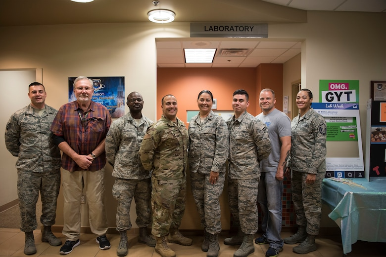 Members assigned to the 30th Medical Support Squadron Laboratory pose for a photo in celebration of Medical Laboratory Professionals Week, also known as Labe Week, April 24, 2019, Vandenberg Air Force Base, Calif. Lab Week is an annual observance to spread awareness and show appreciation to medical laboratory professionals and pathologists for the work they do to assist patients. (U.S. Air Force photo by Airman 1st Class Hanah Abercrombie)