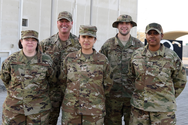 380th Air Expeditionary Wing Command Post personnel pose for a group photo April 25, 2019, Al Dhafra Air Base, United Arab Emirates.