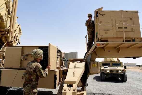 Aaron Albin (left) and Brian Madigan (right), both Private 2nd Class with Bravo Battery, 1st Battalion, 43rd Air Defense Artillery Regiment, perform a system validation on a Patriot launcher April 24, 2019, on Al Dhafra Air Base, United Arab Emirates.