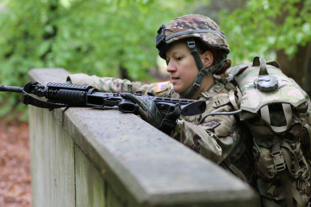 U.S. Army Reserve Spc. Kathryn Hubble, a combat medic healthcare specialis with the 209th Digital Liaison Detachment, 7th Mission Support Command (MSC), Wiesbaden, Germany, tackles the low wall while maneuvering the obstacle course during the 7th MSC Best Warrior Competition (BWC) in Kaiserslautern, Germany, April 26, 2019. BWC is an annual event designed to test the physical fitness, military knowledge, marksmanship, endurance and land navigational skills of each competitor. (U.S. Army Reserve photo by Sgt. Christopher Stelter, 221st Public Affairs Detachment)