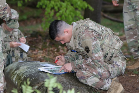 U.S. Army Reserve Staff Sgt. Khristopher Copple, an air missile defense operator with the 2500th Digital Liaison Detachment, 7th Mission Support Command (MSC), Vicenza, Italy, plots points on his map before maneuvering the land navigation course during the 7th MSC Best Warrior Competition (BWC) in Kaiserslautern, Germany, April 26l, 2019. BWC is an annual event designed to test the physical fitness, military knowledge, marksmanship, endurance and land navigational skills of each competitor. (U.S. Army Reserve photo by Sgt. Christopher Stelter, 221st Public Affairs Detachment)