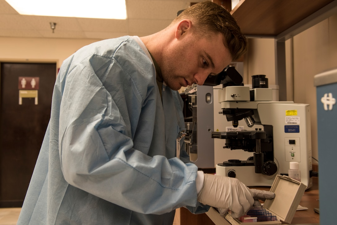 Staff Sgt. Jake Henry, 39th Medial Support Squadron laboratory technician, analyzes a sample March 28, 2019, at Incirlik Air Base, Turkey. Lab technicians test blood samples, as well as assit primary care managers in treating patients based on their analysis. (U.S. Air Force photo by Staff Sgt. Matthew J. Wisher)