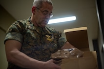 Navy Capt. James T. Quinn, an administration officer and pediatric dentist with 4th Dental Battalion, 4th Marine Logistics Group, Marine Forces Reserve, grabs a Meal, Ready to Eat for lunch at Ponce, Puerto Rico, April 26, 2019, during Innovative Readiness Training Puerto Rico. MARFORRES Sailors are working jointly with several National Guard and Reserve units from across the nation to provide medical care in Puerto Rico during a two-week medical exercise.