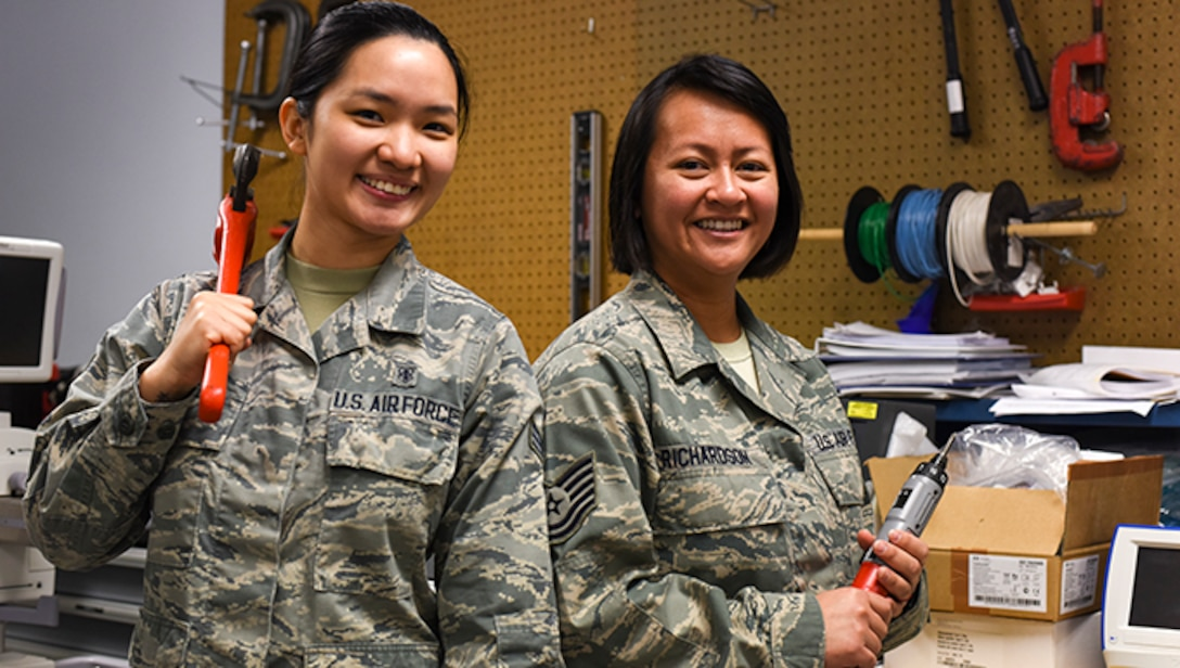 Tech. Sgt. Kristine Richardson, 39th Medical Support Squadron biomedical equipment NCO in charge, right, and Senior Airman Kirsten Lee, 39th MDSS biomedical equipment technician, left, pose for a photo April 18, 2019, at Incirlik Air Base, Turkey. Biomedical equipment techs advise medical staff and other agencies on biomedical equipment operational theory, physiological principles and safe applications. (U.S. Air Force photo by Staff Sgt. Matthew J. Wisher)