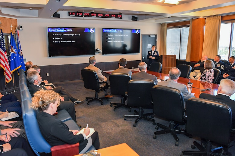 Col. Jennifer Grant, 50th Space Wing commander, briefs attendees on the Schriever mission, vision and priorities during the annual State of the Base at Schriever Air Force Base, Colorado, April 25, 2019. Attendees spent the morning learning about the installation's progress and future endeavors. (U.S. Air Force photo by Kathryn Calvert)