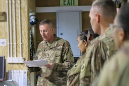 Chief Warrant Officer 3 Kim Ralston, 184th Sustainment Command, briefs members of the 1st Theater Sustainment Command's Syrian Logistics Cell in Erbil, Iraq, April 24, 2019.