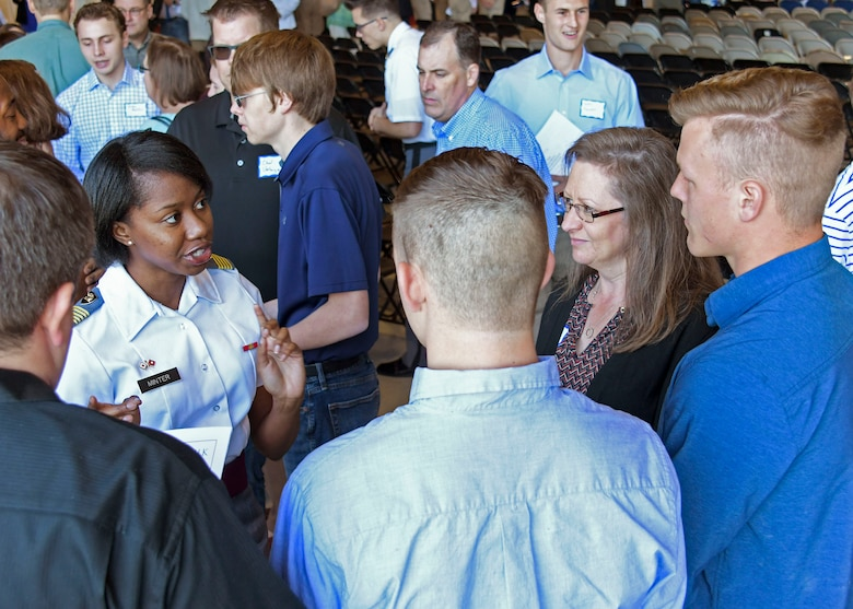 A United States Military Academy student talks with a high school student about what it is like to attend a military academy at Dobbins Air Reserve Base, Ga. on April 27, 2019. Dobbins hosted the 20th annual Academy Day, where representatives from all the military service academies come to talk with potential attendees, and students come to meet congressional representatives (U.S. Air Force photo by Tech. Sgt.  Miles Wilson).