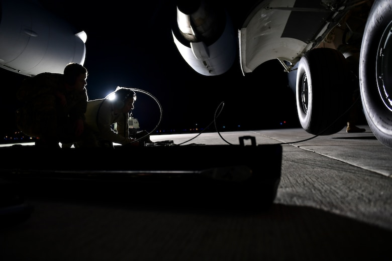 Crew chiefs assigned to the 911th Aircraft Maintenance Squadron watch as a C-17 Globemaster III is raised during a thru-flight inspection at the Pittsburgh International Airport Air Reserve Station, Pennsylvania, April 16, 2019.