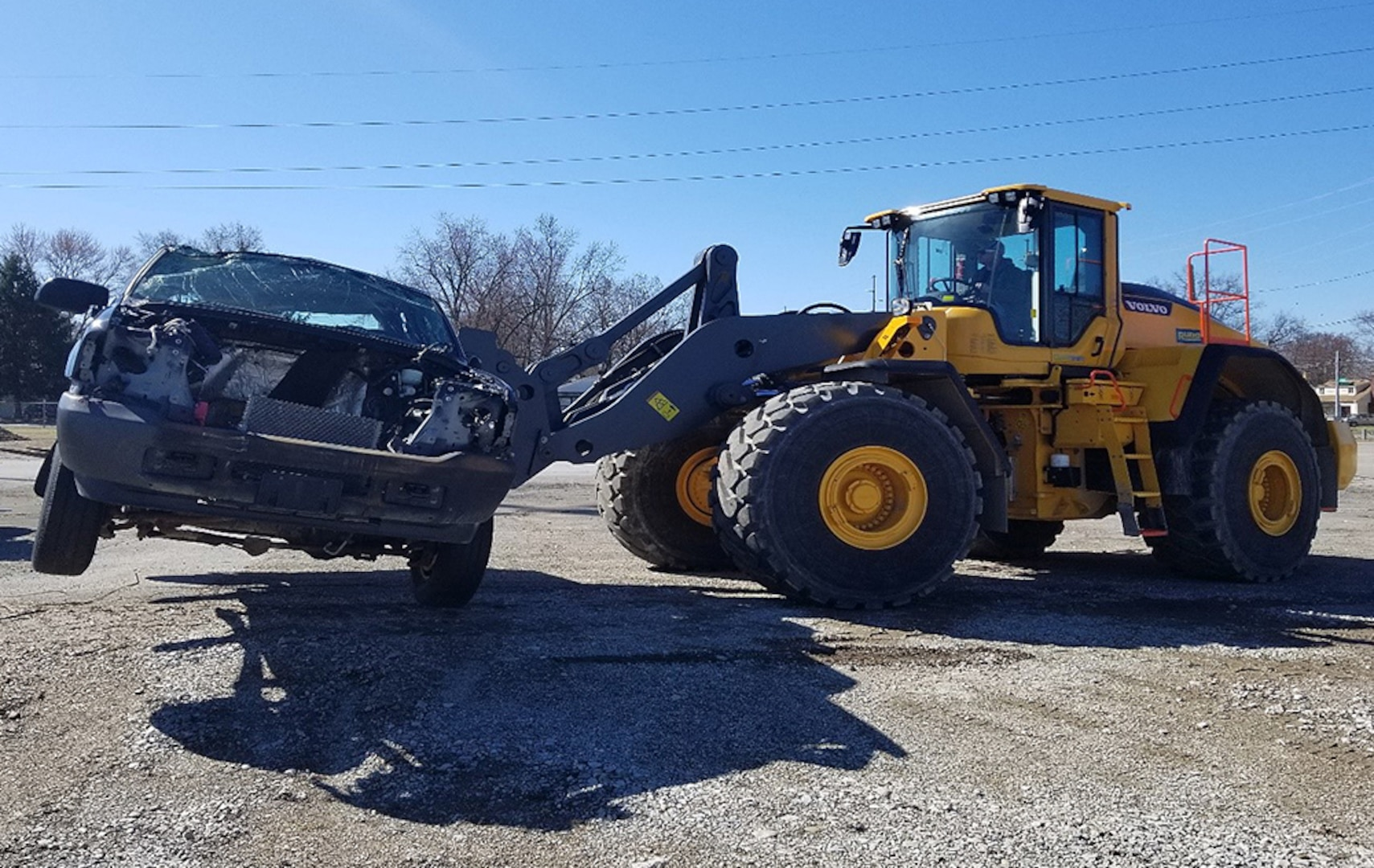 Material Examiner and Identifier Jared Vierheller maneuvers a scrap-pile Ford F-350 during advanced material handling equipment training held in Columbus, Ohio, in April. Vierheller is one of five Columbus-based agency employees currently earning on-the-job credit hours toward certification.