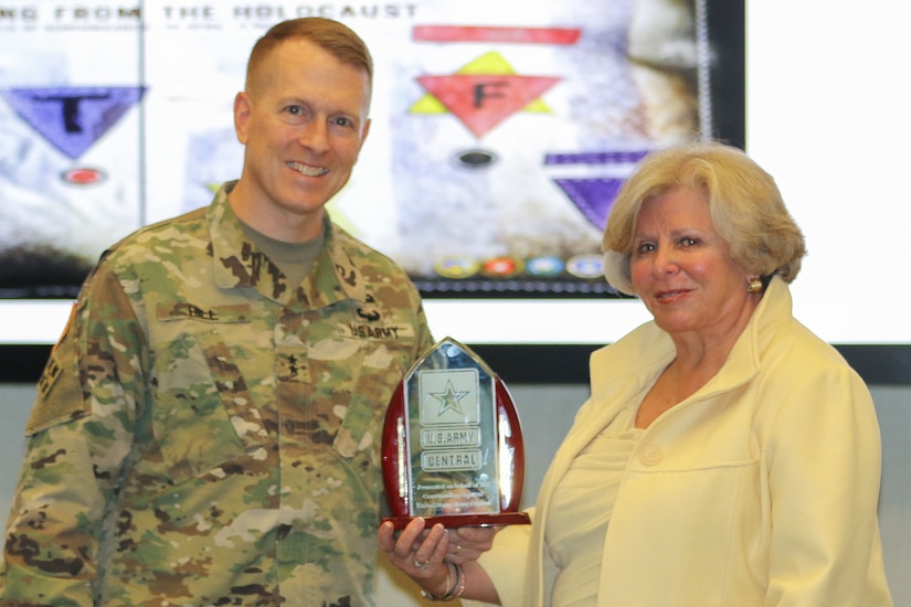 Maj. Gen. David C. Hill, deputy commanding general, U.S. Army Central, presents a gift to Dr. Lilly Stern Filler, chair of the South Carolina Council on the Holocaust and the ceremony guest speaker, during the Days of Remembrance observance ceremony at USARCENT headquarters on Shaw Air Force Base, S.C., April 24, 2019. Congress established the Days of Remembrance as the nation's annual commemoration of the Holocaust.