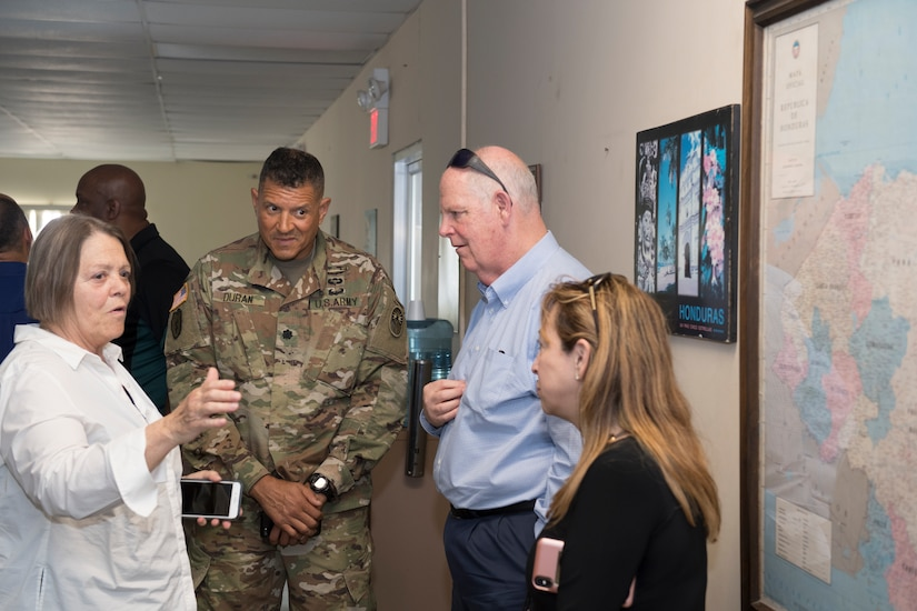 U.S. Army Lt. Col. Rafael Duran (center left), Joint Task Force - Bravo joint operations director, explains the geographic area of Honduras to congressional delegation members and their spouses during a region visit April 27, 2019, at Soto Cano Air Base, Honduras. The delegates visited U.S. allies in Central and South America to update members of congress on the regional stability and preserve relationships in the area. (U.S. Air Force photo by Staff Sgt. Eric Summers Jr.)