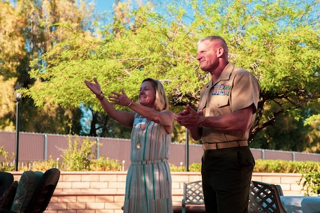U.S. Marine Corps Brig. Gen. Roger Turner, commanding general, Marine Air Ground Task Force Training Center (MAGTFTC), Marine Corps Air Ground Combat Center (MCAGCC), Twentynine Palms, Calif., and his wife, Carol Turner, applaud Marines who volunteered to host an Earth Day celebration at their home, April 24, 2019. The event was part of MCAGCC's annual observance of Earth Day which includes multiple events aimed at fostering awareness of environmental conservation on and around the Marine Corp's largest training installation. (U.S. Marine Corps photo by Cpl. Dallas Johnson)