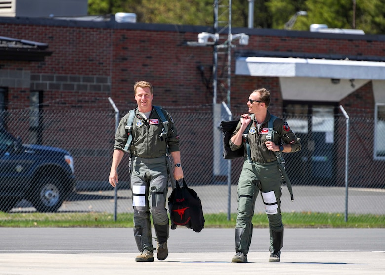 Lt. Col. Nathaniel 'Kona' Zajac and Maj. Mark 'Mr. Chow' Silvers, 104th Fighter Wing pilots, walk onto the flight line prior to training with the Royal Canadian Air Force April 25, 2019, at Barnes Air National Guard Base, Massachusetts. The 104th FW and the RCAF spent five days conducting dissimilar aircraft training together.