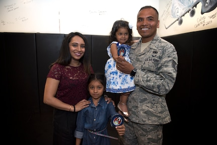Tech. Sgt. Gerardo Hernandez, a Phoenix Raven team lead assigned to the 628th Security Forces Squadron, poses with his wife Sejal and their two daughters, Aalaya and Alenna, April 18, 2019, at Joint Base Charleston, S.C. Due to his busy travel schedule as a Phoenix Raven, Hernandez says he and his family value the limited time they have together more and prioritize family-oriented activities while he is home. The Hernandez family takes advantage of technology like FaceTime and social media to maximize communication and quality time when they are not physically together.