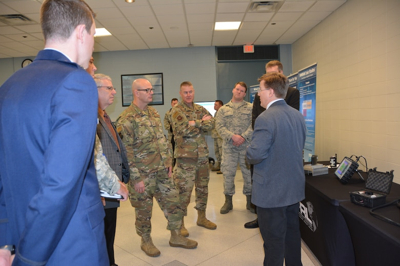 Dr. Eric Lindgren, of the Air Force Research Laboratory, demonstrates the non-destructive inspection/evaluation process to senior leaders from across the Air Force. The demo was part of an AFRL Tech Expo for the Basing and Logistics Board. (U.S. Air Force photo/Karen Schlesinger)