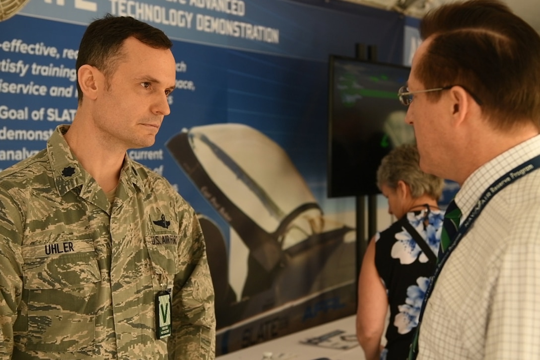 Service member speaking to a man.