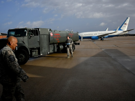 Fuels specialist pull up with a jet fuel truck to pump gas to a waiting C-40 airplane March 14, 2019 at Scott Air Force Base, Illinois.  Maintainers are constantly perfecting their mission: The 932nd Airlift Wing's Maintenance Group (MXG), is responsible for leading people who are always training and equipping to inspect, maintain and repair Air Force Reserve Command C-40C planes at Scott Air Force Base. The 932nd MXG's management of resources improves the wing's professionalism and enables the 932nd Operations Group's C-40C pilots to fly distinguished visitor (DV) airlift around the world, anywhere they are needed by the nation's leaders. The Illinois unit, which is part of 22nd Air Force, under Air Force Reserve Command, flies four of the C-40C planes worldwide. (U.S. Air Force photo by Lt. Col. Stan Paregien)