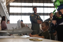 A child observes a model MQ-9 Reaper put on display by the 89th Arrack Squadron during a Doolittle Raider Anniversary Celebration at Ellsworth Air Force Base, South Dakota, April 18, 2019. The 89th ATKS, formerly known as the 89th Reconnaissance Squadron, was one of four original Doolittle Raider squadrons during the 1942 attacks. (U.S. Air Force photo by 1st Lt. Scarlett Trujillo)