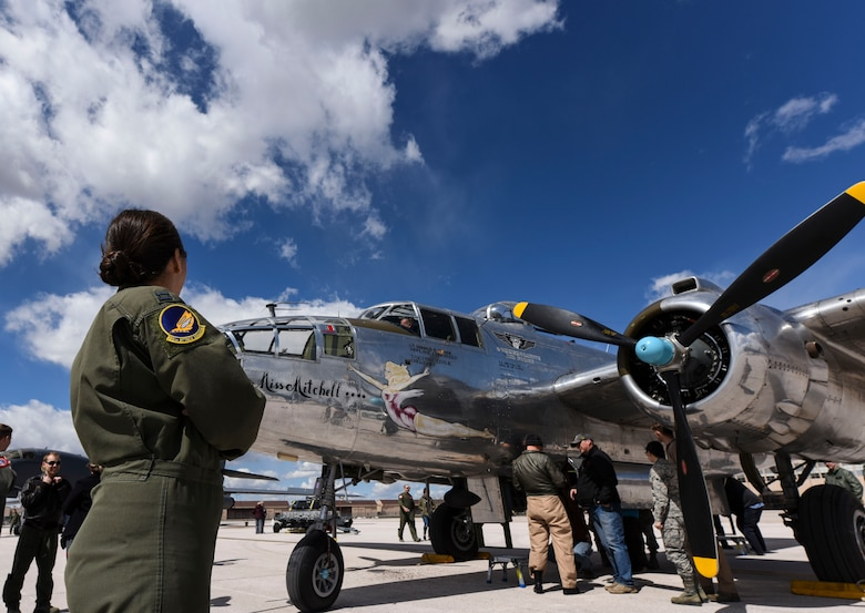 Capt. Sophie, pilot with the 89th Attack Squadron, surveys the B-25B Mitchell on display during a Doolittle Raider Anniversary Celebration at Ellsworth Air Force Base, South Dakota, April 18, 2019. Sixteen B-25B's were used in the Doolittle Raids, and out of those, four belonged to the 89th Reconnaissance Squadron.