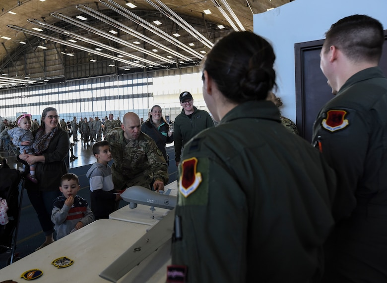 Air crew from the 89th Attack Squadron speak to Airmen and family members during a Doolittle Raider Anniversary Celebration at Ellsworth Air Force Base, South Dakota, April 18, 2019. The 89th ATKS, formerly known as the 89th Reconnaissance Squadron, was one of four original Doolittle Raider squadron during the 1942 attacks. (U.S. Air Force photo by 1st Lt. Scarlett Trujillo)