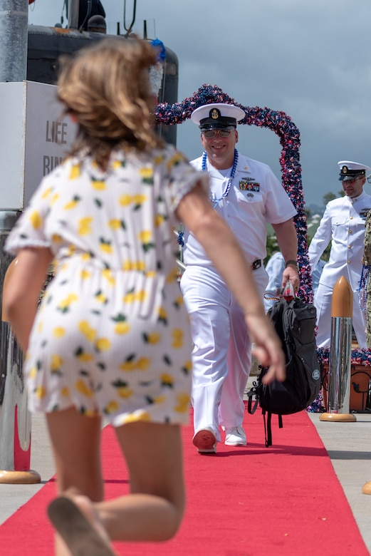 PEARL HARBOR -- A Sailor assigned to the Los Angeles-Class fast-attack submarine USS Santa Fe (SSN 763) greets his family after arriving at Joint Base Pearl Harbor-Hickam, after completing their latest deployment, April 22. (U.S. Navy Photo by Mass Communication Specialist 1st Class Daniel Hinton)