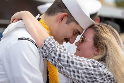 PEARL HARBOR -- Los Angeles-Class fast-attack submarine USS Cheyenne (SSN 773) greets his loved one after he arrived at Joint Base Pearl Harbor-Hickam, after completing their latest deployment, April 26. (U.S. Navy Photo by Mass Communication Specialist 1st Class Daniel Hinton)