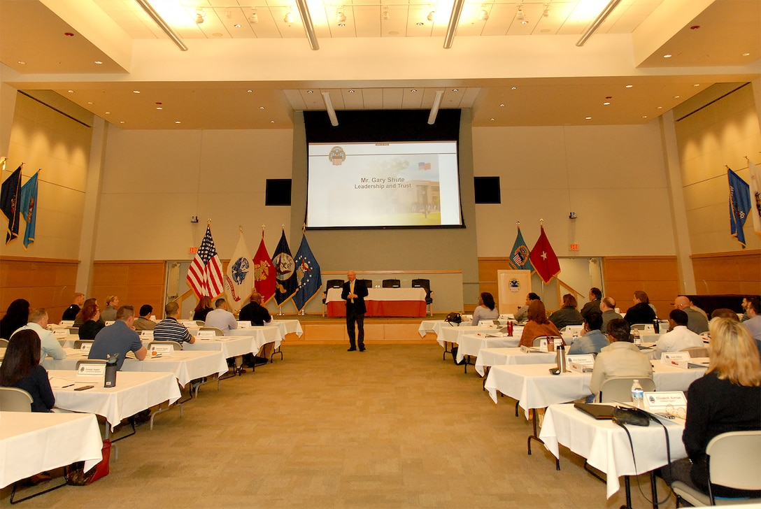 Keynote speaker Gary Shute, a former DLA Troop Support Clothing and Textiles supplier operations director, center, speaks to attendees of the DLA Troop Support Leadership Academy April 23, 2019 in Philadelphia.