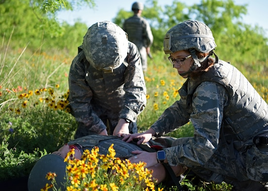 Angelo State University Air Force ROTC Cadets administer medical aid on a practice dummy during their field training exercise at Goodfellow Air Force Base, Texas, April 25, 2019. ROTC students from ASU were given assigned roles such as medics, translators and fireteam leaders to simulate a deployed environment. (U.S. Air Force photo by Airman 1st Class Ethan Sherwood/Released)
