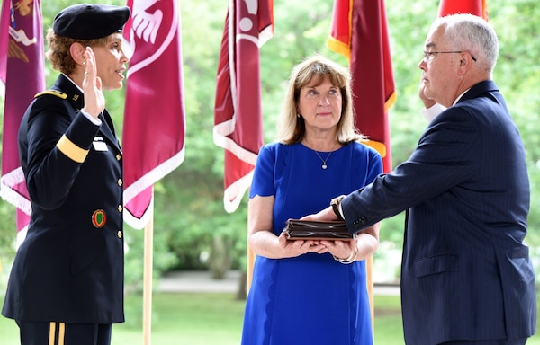 Lt. Gen. Nadja Y. West administers the oath of office to Joseph M. Harmon III, as his wife Alice looks on. Harmon, deputy to the Commanding General, U.S. Army Medical Department Center and School, Health Readiness Center of Excellence, or HRCoE, at Joint Base San Antonio-Fort Sam Houston, was appointed to the Senior Executive Service in a ceremony at the Army Medical Department Museum April 29.