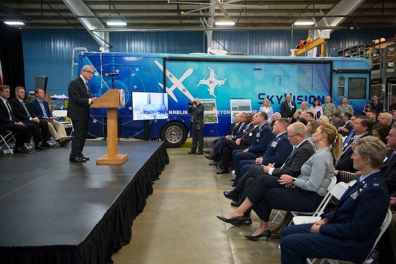 Ohio Governor Mike DeWine addresses those attending the announcement of the Federal Aviation Administration granting a Certificate of Waiver or Authorization to the Air Force Research Laboratory for beyond visual line of sight flights of unmanned aerial systems during an event at the Sprinfield-Beckley Municipal Airport April 26, 2019. (U.S. Air Force photo by R.J. Oriez)