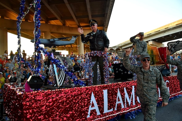 Col. David A. Scott, 433rd Airlift Wing vice commander, waves to the crowd during the 71st annual Fiesta Flambeau Parade, April 27, 2019.