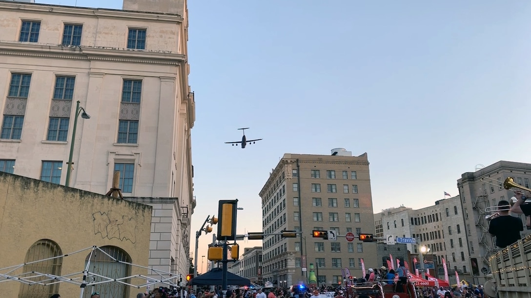 A 433rd Airlift Wing C-5M Super Galaxy flies over the Alamo at an altitude of 1,000 feet as the sun sets in downtown San Antonio as it approaches the Alamo during the 71st annual Fiesta Flambeau Parade, April 27, 2019.