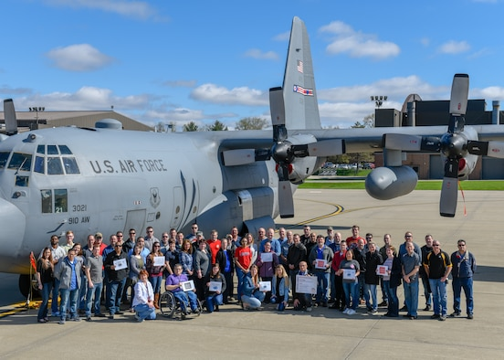 Members of the 910th Airlift Wing pose in front of a C-130H Hercules aircraft here, April 24, 2019, for Denim Day.