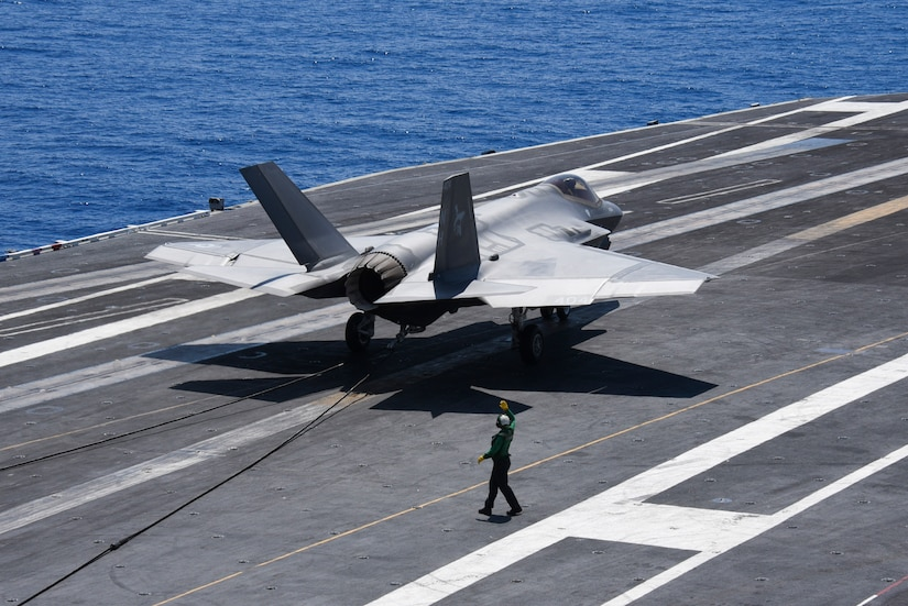 An F-35C Lightning II aircraft assigned to Strike Fighter Squadron (VFA) 147 makes an arrested landing during flight operations aboard the Nimitz-class aircraft carrier USS Abraham Lincoln (CVN 72). Abraham Lincoln is currently underway conducting carrier qualification.