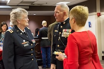 U.S. Marine Corps Forces Command Commanding General Lt. Gen. Mark Brilakis, center, talks to U.S. Army Ret. Col. Margarethe Cammermeyer, an honorary chair, prior to the 2019 Virginia International Tattoo at the Norfolk Scope in Norfolk, Virginia, April 26, 2019.