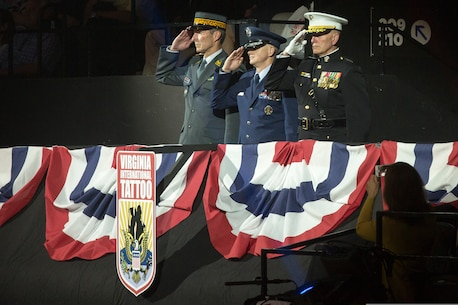 U.S. Marine Corps Forces Command Commanding General Lt. Gen. Mark Brilakis, right, takes the Honorary Salute alongside U.S. Air Force Lt. Gen. Christopher Weggeman, the deputy commander of Air Combat Command, and Swiss Army Major General Peter Wanner during the 2019 Virginia International Tattoo at the Norfolk Scope in Norfolk, Virginia, April 26, 2019.