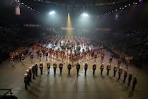 All performers stand in formation during the finale of the 2019 Virginia International Tattoo at the Norfolk Scope in Norfolk, Virginia. Brilakis took part in the Honorary Salute alongside U.S. Air Force Lt. Gen. Christopher Weggeman, the deputy commander of Air Combat Command, and Swiss Army Major General Peter Wanner,  April 26, 2019.