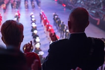 U.S. Marine Corps Forces Command Commanding General Lt. Gen. Mark Brilakis, right, applauds during the 2019 Virginia International Tattoo at the Norfolk Scope in Norfolk, Virginia, April 26, 2019.