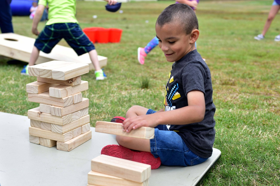A young boy plays with blocks.