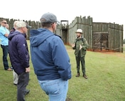 Ryan O'Connell, seasonal park guide, Andersonville National Historic Site, explains to Marines the hardships prisoners of war endured at Camp Sumter, commonly known as the Andersonville Prison, during a recent tour.