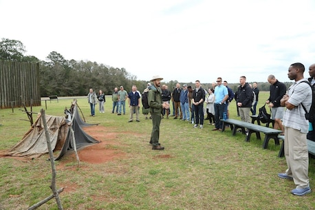 Ryan O'Connell, seasonal park guide, Andersonville National Historic Site, explains to Marines the living conditions prisoners of war endured at Camp Sumter, commonly known as the Andersonville Prison, during a recent tour.